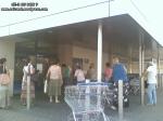coada supermarket-urile distrug economia Romaniei efectele supermarketurilor asupra economiei locale magazine hypermarket butic cartier bani scosi din tara distrugerea afaceri familie profit 7